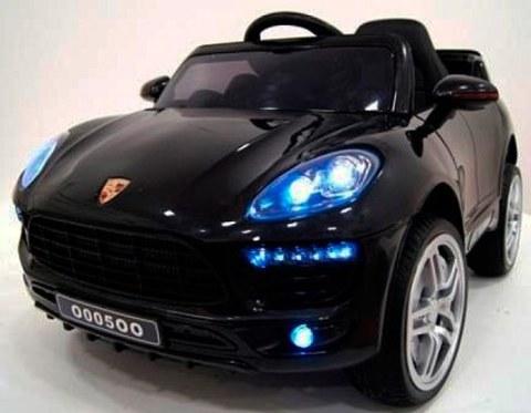 Детский электромобиль Rivertoys Porsche Macan О 005 ОО VIP черный сиденье кожа