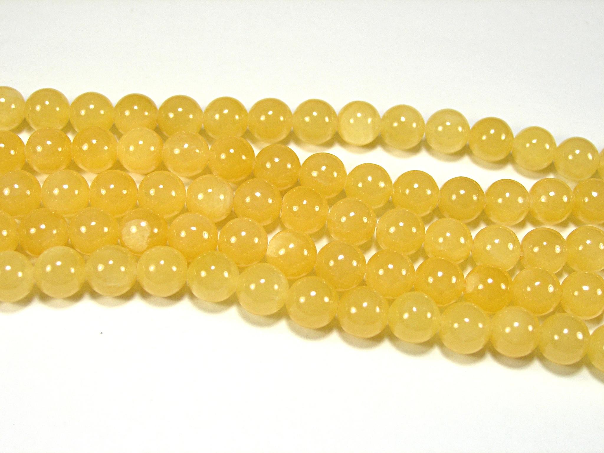 Нити бусин из жадеита медового, шар гладкий 8мм (оптом)