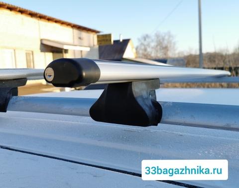 Багажник Интер Фаворит на рейлинги  с аэро дугой с замком 120 см.