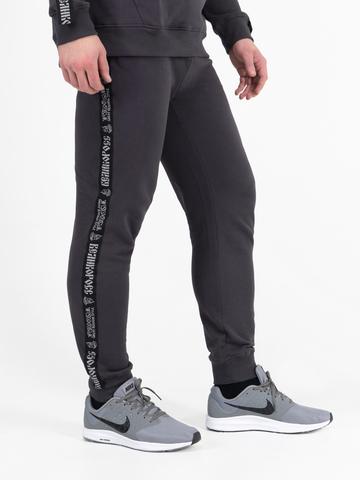 Спортивные штаны графитового цвета с лампасами, с манжетами