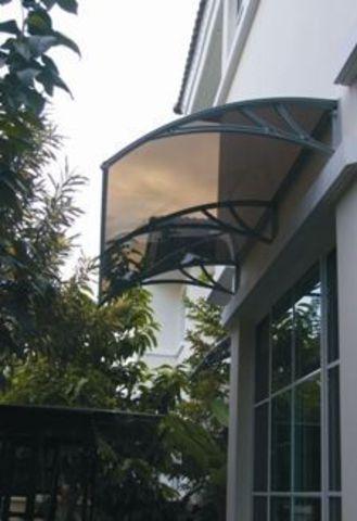 бронзовый козырек кровент над террасным окном