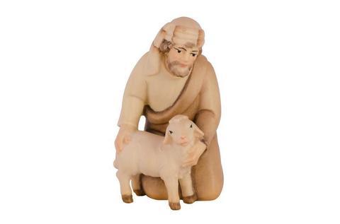 Наклонившийся пастух с ягненком