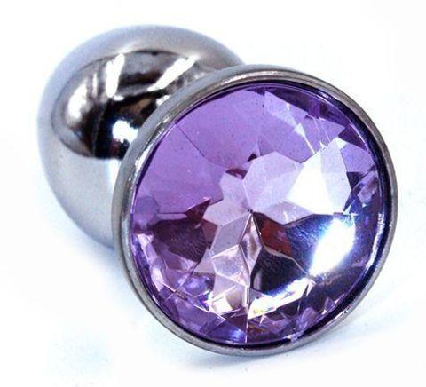 Серебристая анальная пробка с фиолетовым стразом - 7 см.