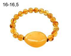 браслет из янтаных шаров и крупной янтарной бусины, фото
