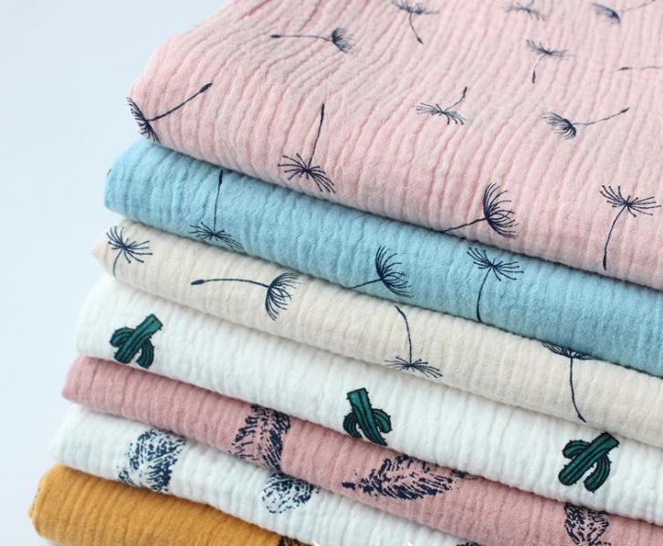Ткань муслиновая,одуванчики на розовом