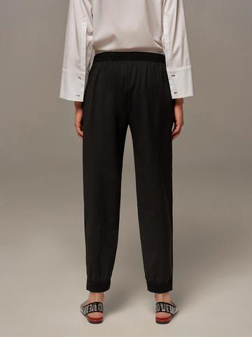 Женские брюки черного цвета с лампасами - фото 3