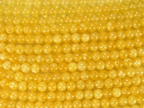 Нить бусин из кальцита желтого, шар гладкий 6мм