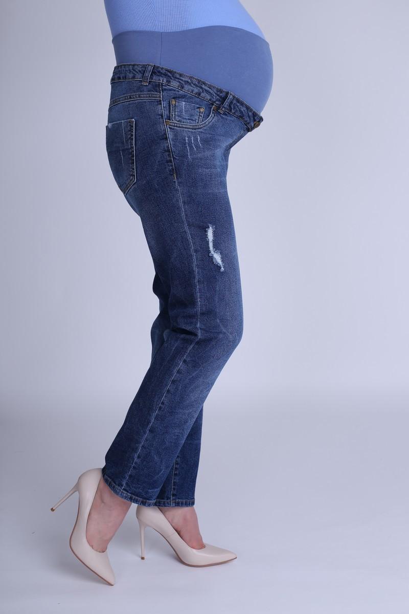 Фото свободные джинсы для беременных MAMA`S FANTASY, укороченные брючины, широкий бандаж от магазина СкороМама, синий, размеры.