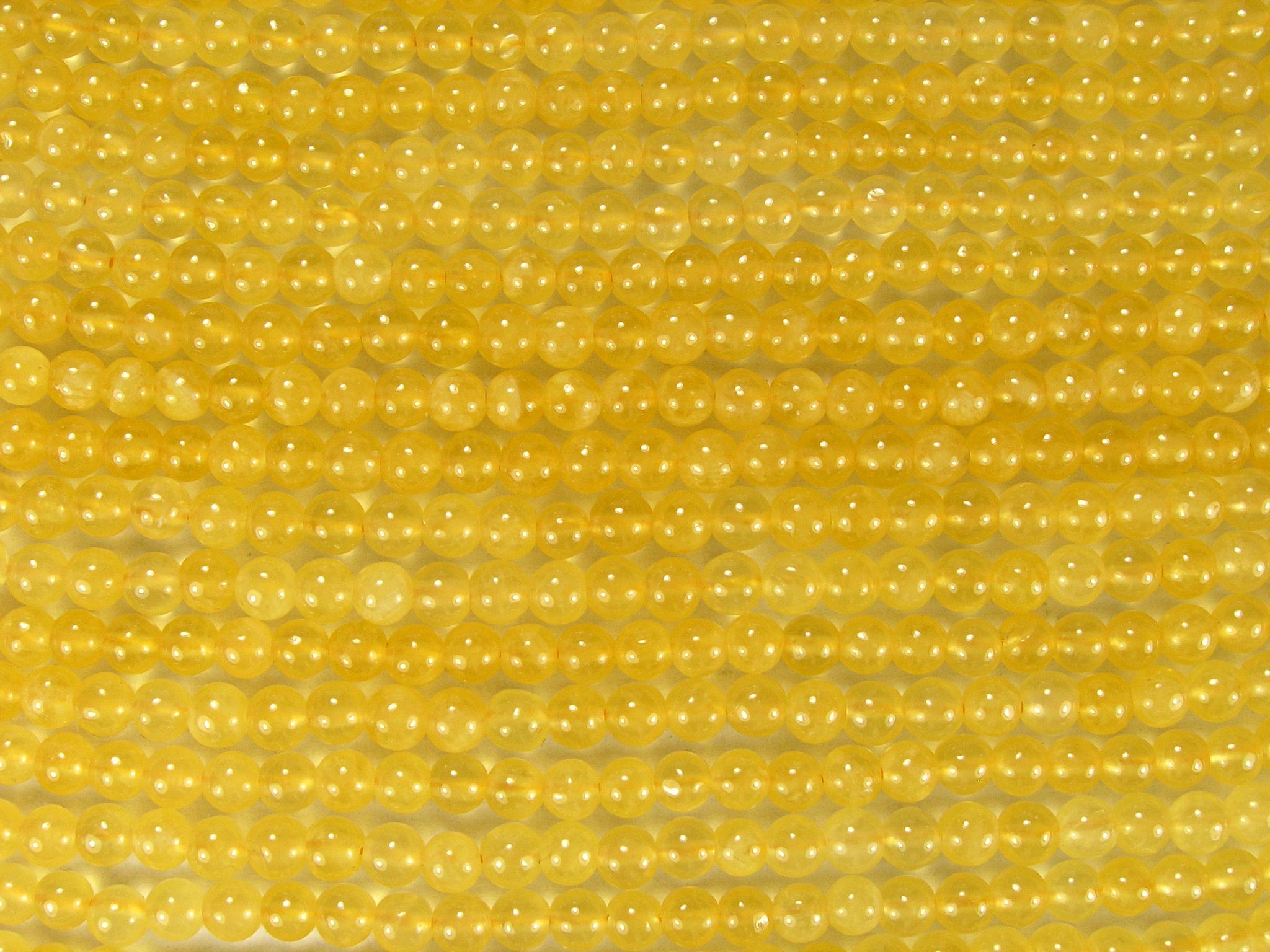 Нить бусин из кальцита желтого, шар гладкий 4мм