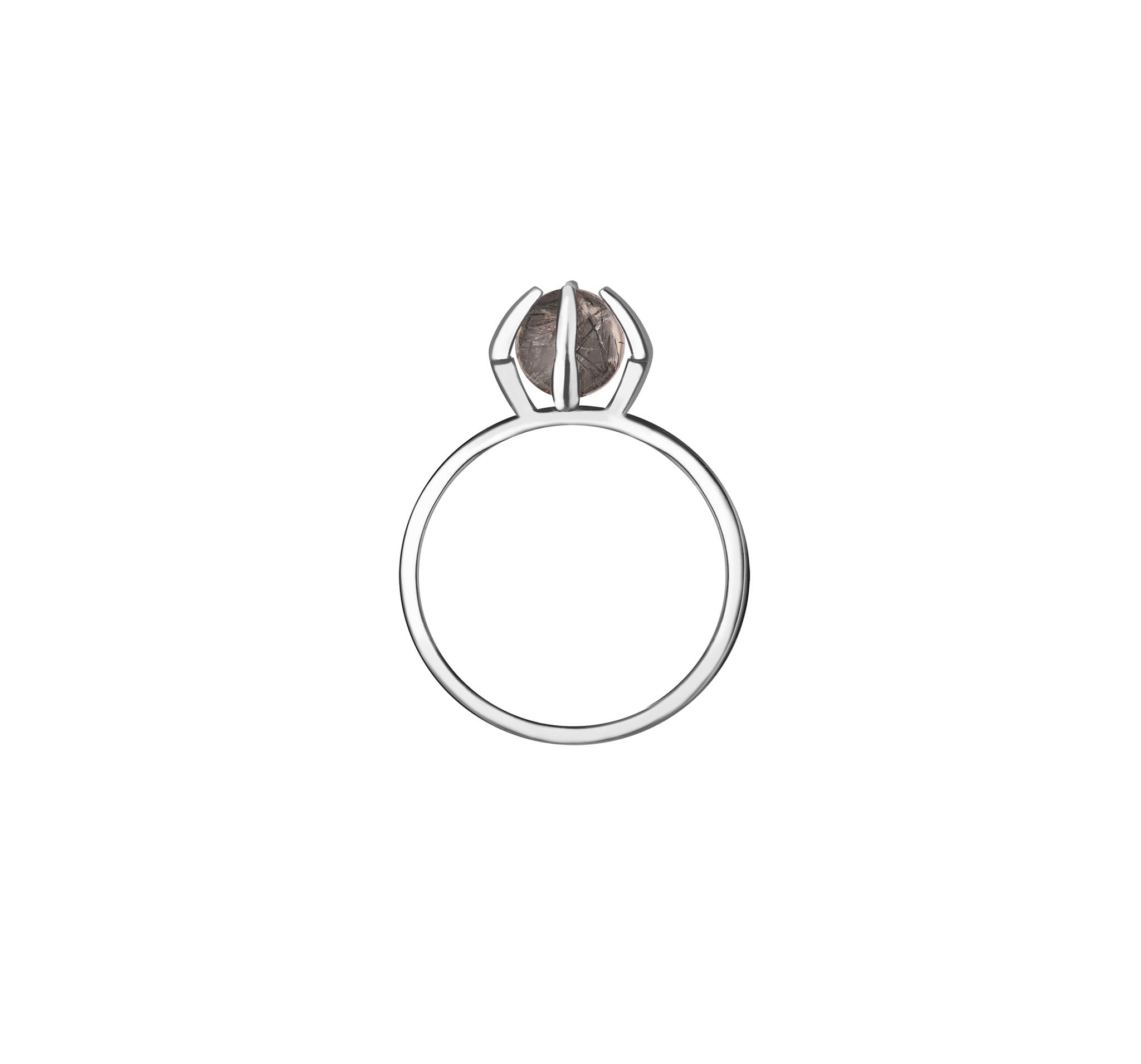 Кольцо из серебра, покрыто родием и дополнено натуральным рутиловым кварцем.