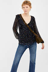 Блуза з принтом і оборками
