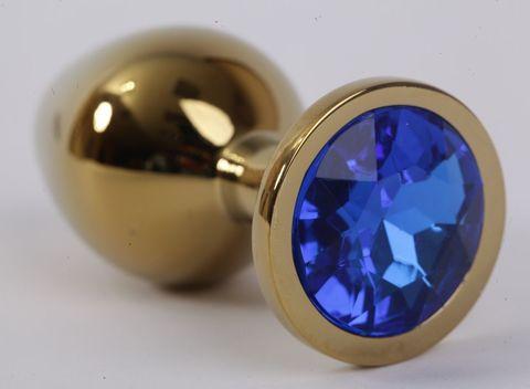 Золотистая анальная пробка с синим кристаллом - 9,5 см.