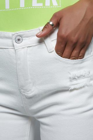 Женские белые джинсы с дырками магазин