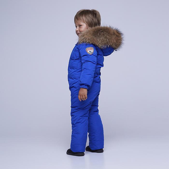 Дитячий однотонний зимовий комбінезон блакитного кольору і опушкою з натурального хутра