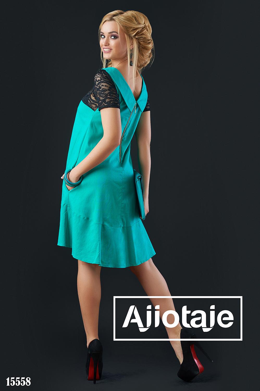 Бирюзовое платье А-силуэта с вырезом на спинке