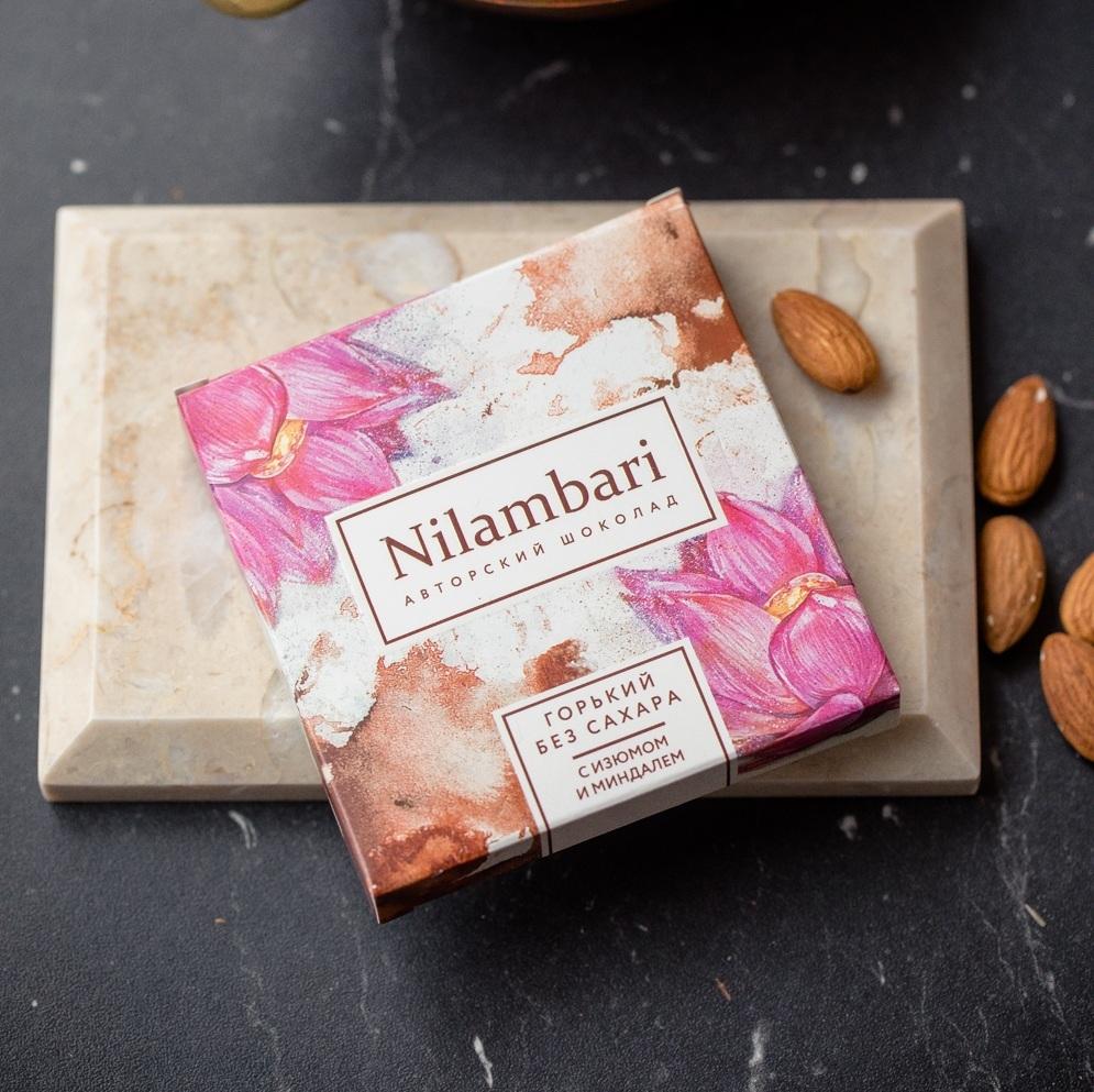 Фотография Шоколад Nilambari горький с миндалем и изюмом, 65 г купить в магазине Афлора