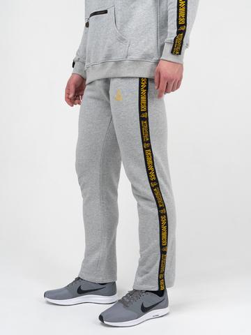 Спортивные штаны цвета серый меланж с лампасами, без манжета