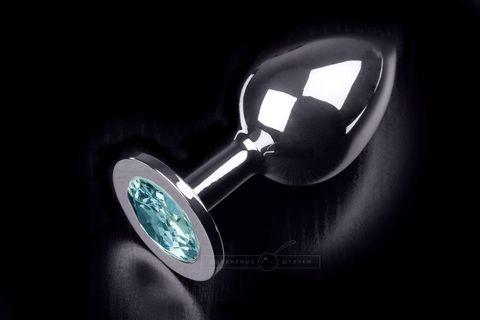 Большая серебристая анальная пробка с круглым кончиком и ярким голубым кристаллом - 9 см.