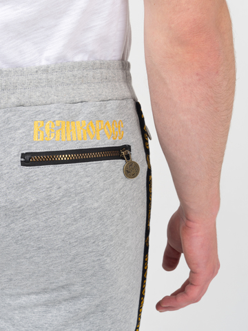Спортивные штаны цвета серый меланж с лампасами, с манжетами
