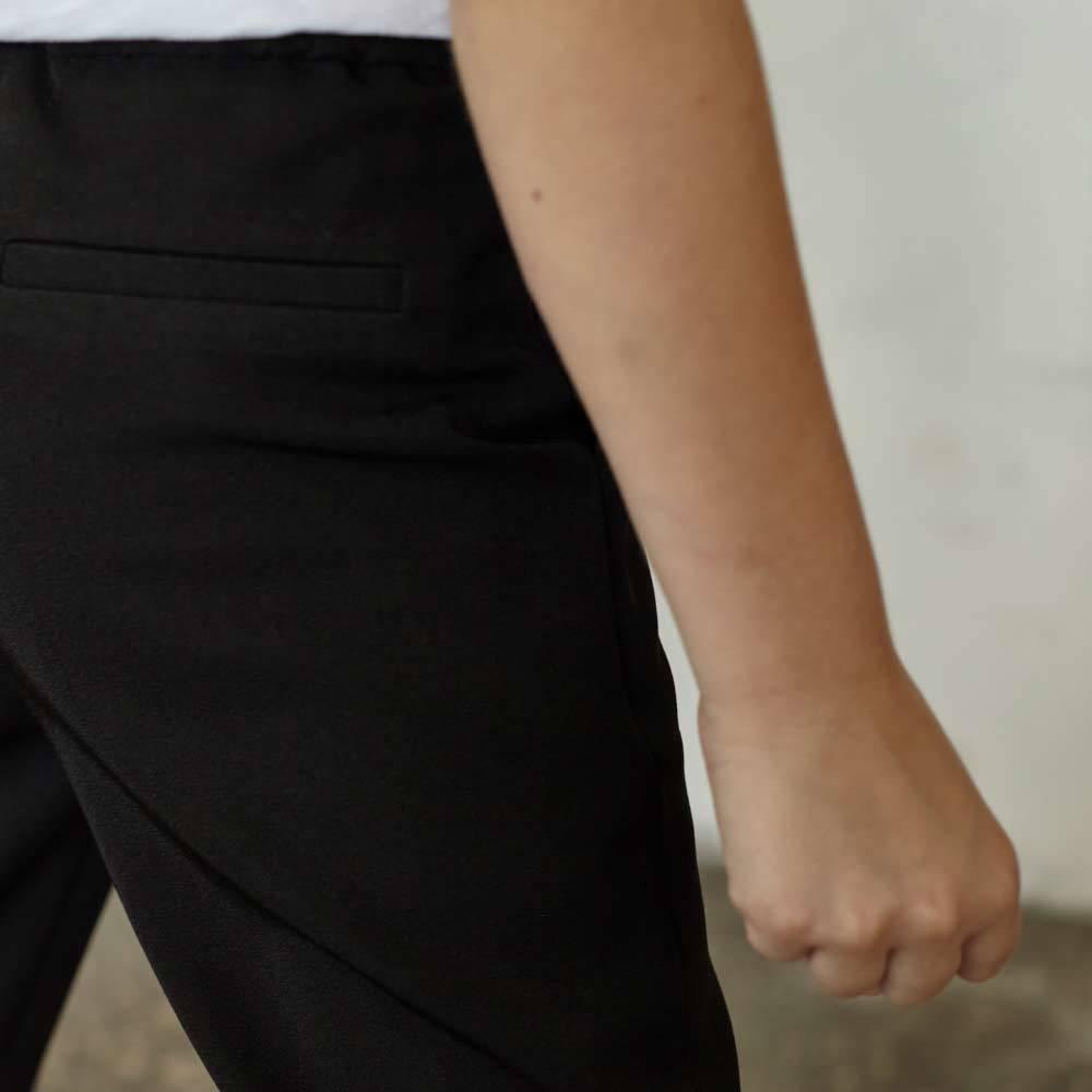 Детские брюки для девочки в черном цвете