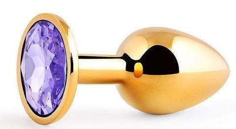 Золотистая анальная пробка с фиолетовым стразом - 7,2 см.