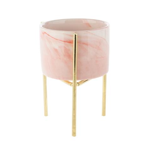Розовое кашпо на золотой подставке