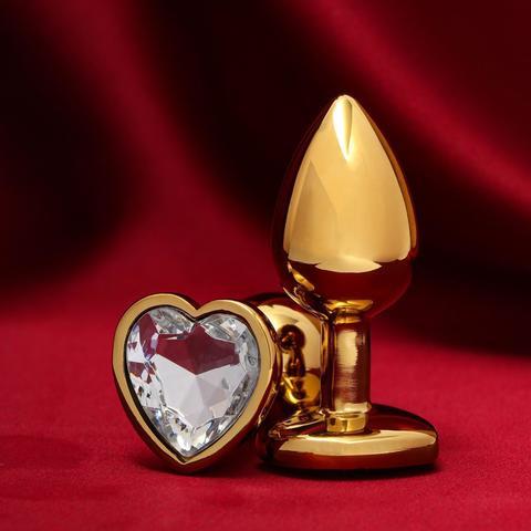 Анальная золотая пробка с прозрачным кристаллом в форме сердца (малая)