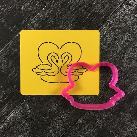 Сердце с лебедями