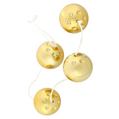 Четыре золотистых вагинальных шарика -