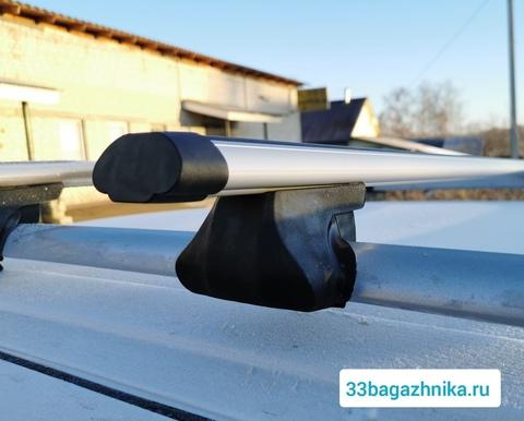 Багажник на рейлинги Интер Фаворит с аэро дугой 140 см.