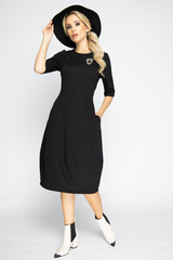 """<p><span>Это платье - самый простой способ изменить свои образ и настроение! Платье отрезное по талии и юбкой """"баллон"""" с карманами.Элемент """"Брошь"""" в комплект не входит (можно приобрести в разделе """" Аксессуары""""). (Длина: 44-106см; 46-107см; 48-108см; 50-109 см)</span></p>"""