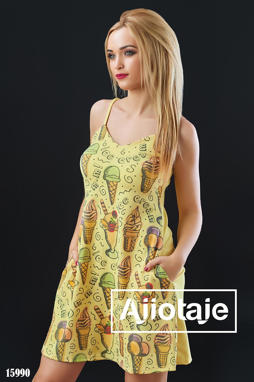 Платье на тонких бретелях желтого цвета