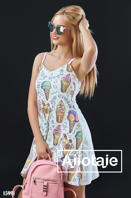 Платье на тонких бретелях молочного цвета