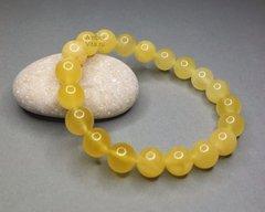 браслет из янтарных жёлтых шаров