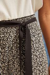 Довгі штани з принтом в дрібну квіточку