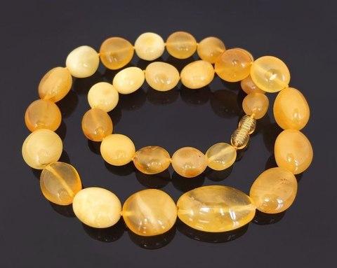 эксклюзивные бусы из крупного янтаря медовых оттенков