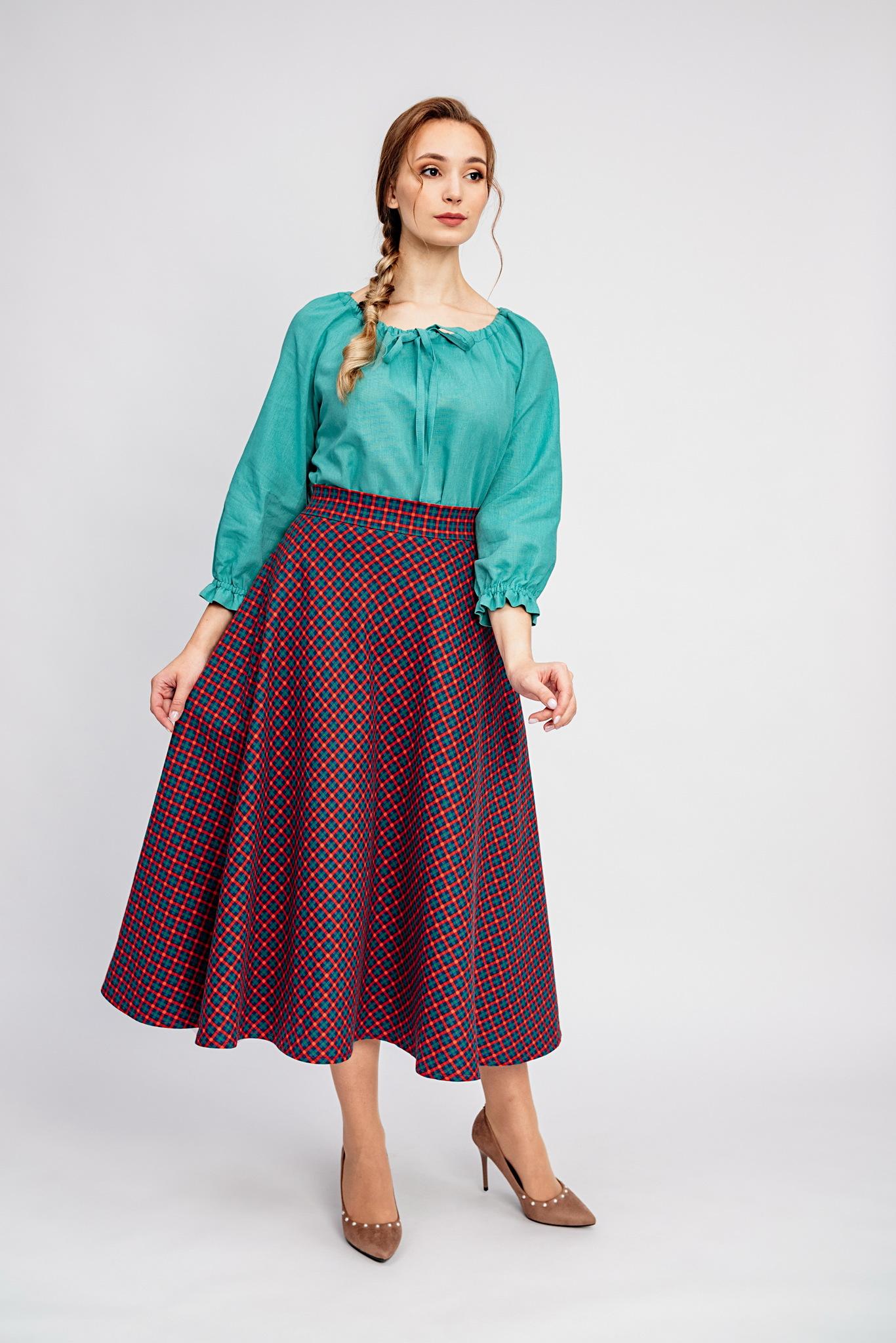 Тёплая юбка с карманами в клетку