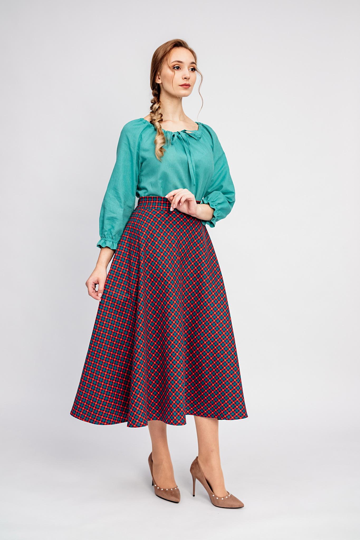 Теплая юбка в клетку с карманами миди