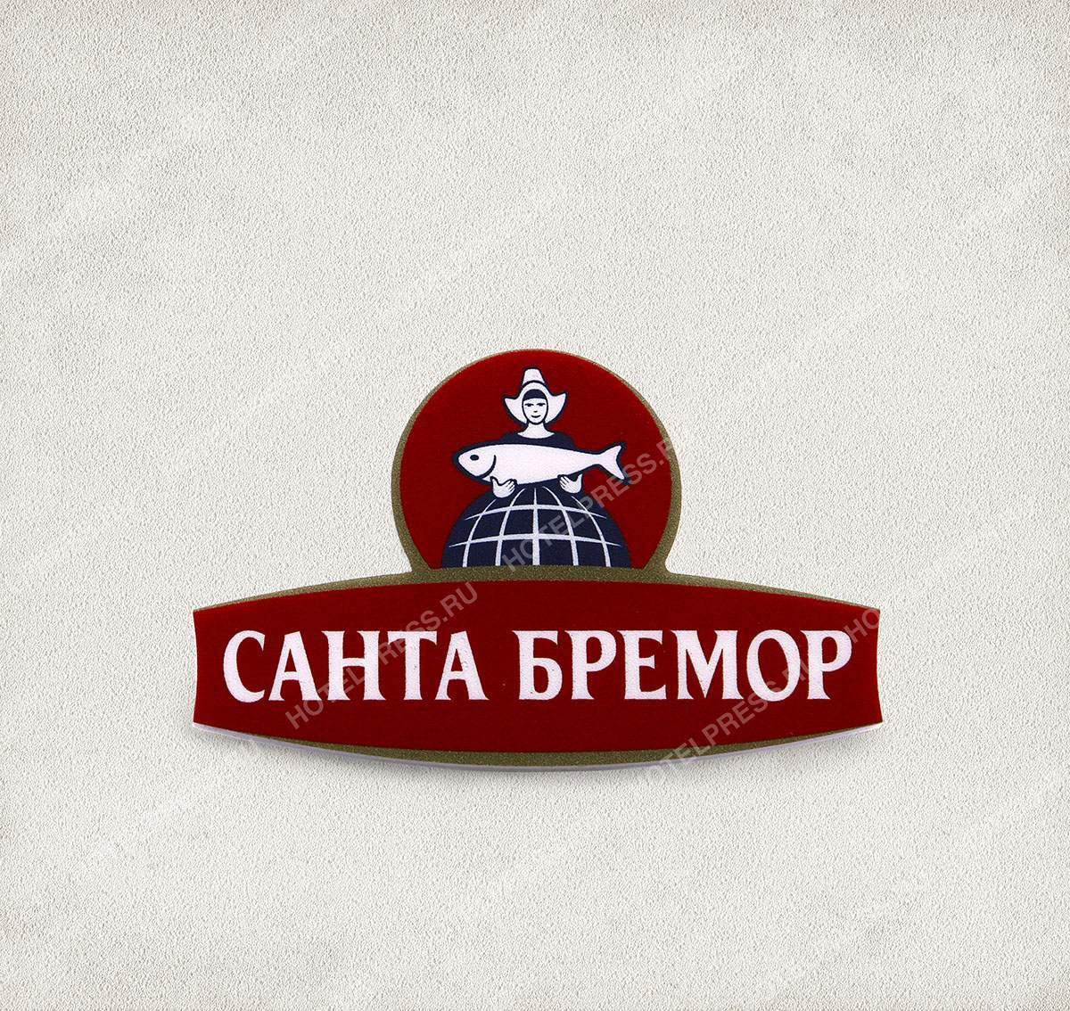 """Фирменный бейдж продовольственной компании """"САНТА БРЕМОР"""""""