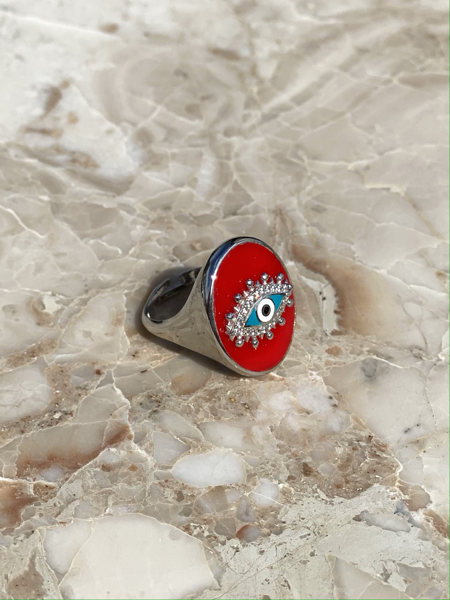 The Eye signet ring in silver with red and blue enamel