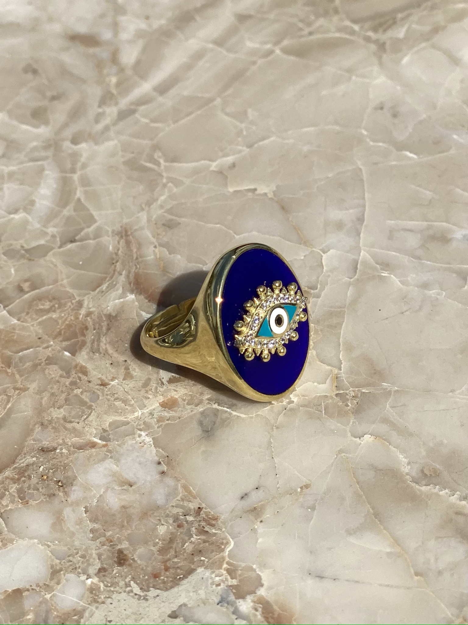 The Eye signet ring in gold plated silver with blue enamel