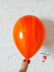 Оранжевый мраморный шар