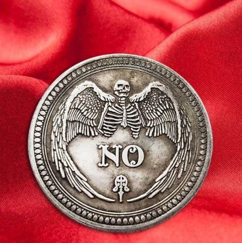 Сувенирная монета для принятия решений
