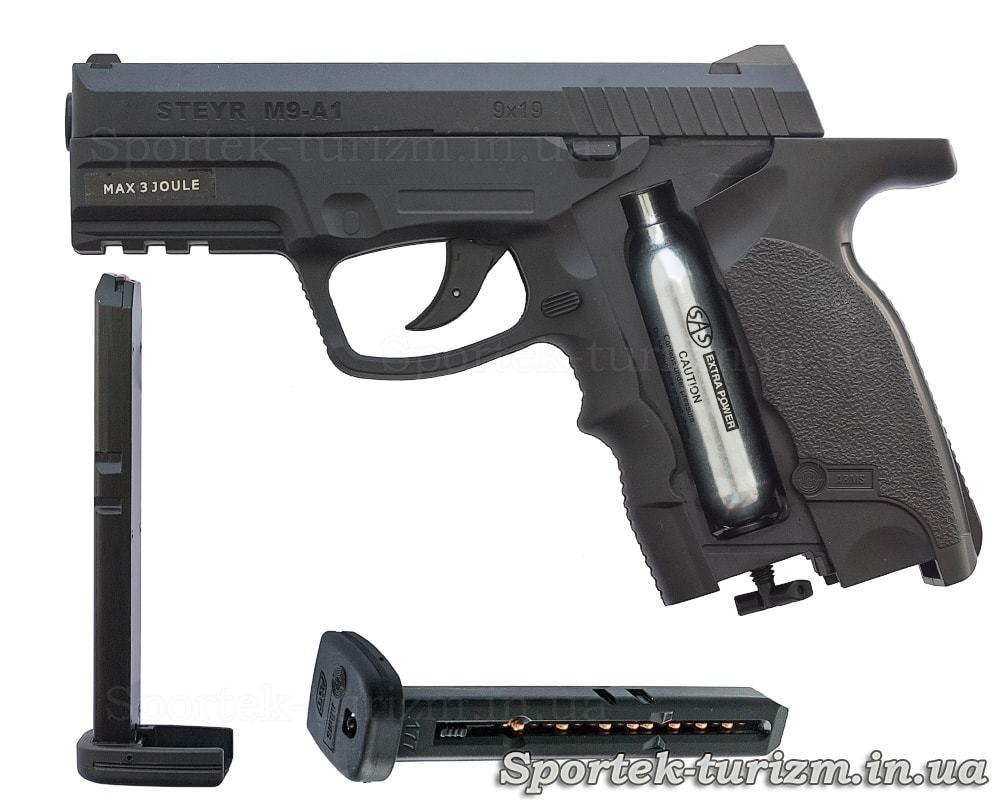 Пістолет пневматичний ASG Steyr M9-A1 4,5мм чорний, споряджений і магазин з кульками