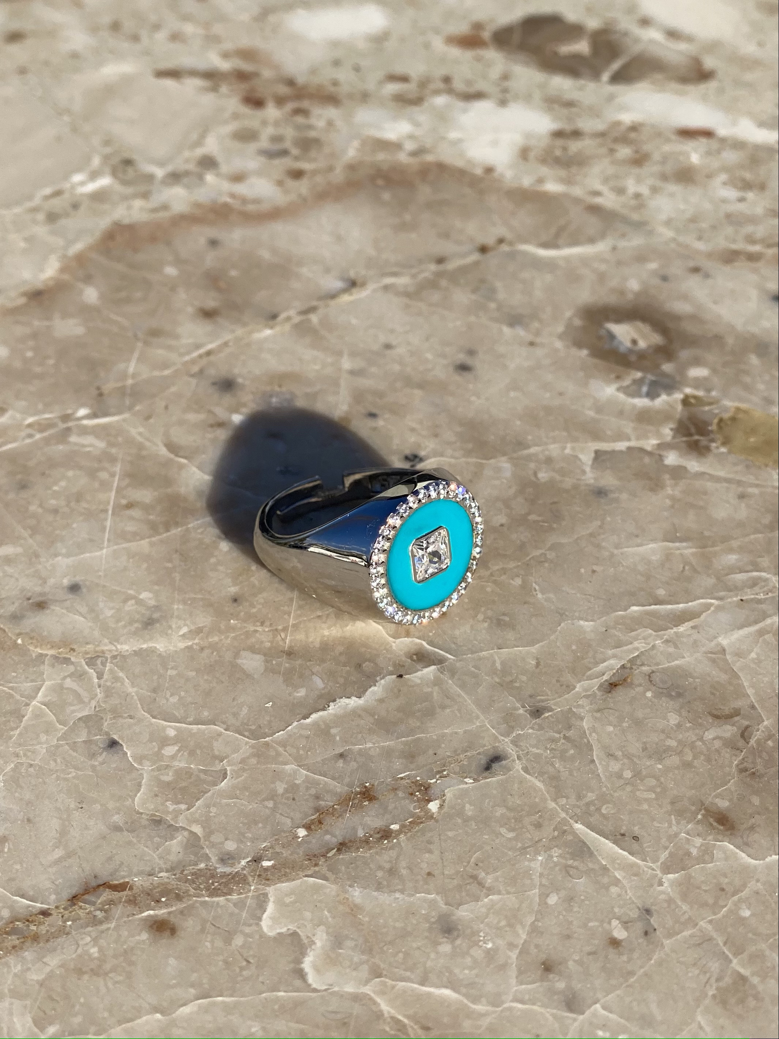 Round signet ring in silver and light blue enamel